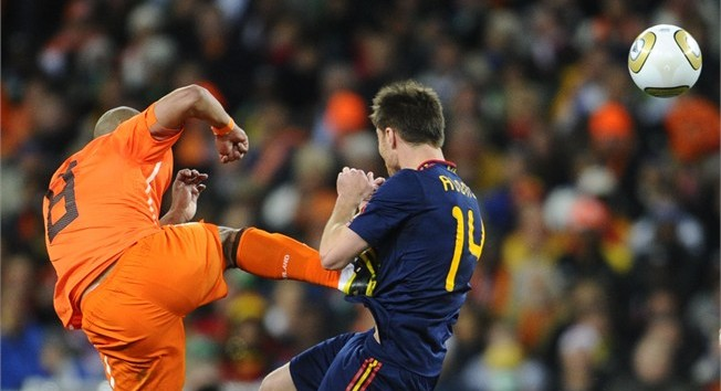 Nigel de Jong gives Xabi Alonso the Dutch treatment in the World Cup final. Photo: fifa.com.