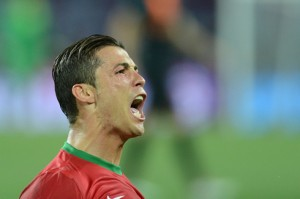 cristiano ronaldo 520 screaming and yelling for portugal at the euro 2012 with his typical second half hairstyle 300x199 Ronaldo plans to cap a magic year by sinking Spain