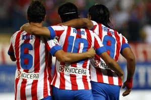 Atletico's players celebrate.