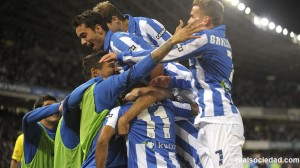 Real Sociedad celebrate after scoring against Athletic Bilbao.