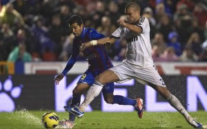 Pepe challenges for the ball.