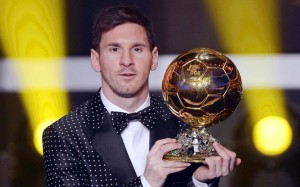 Leo Messi with the Ballon d'Or trophy.