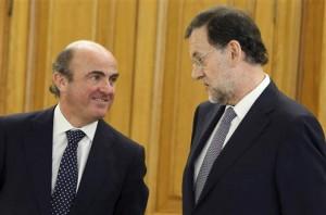 Luis de Guindos and Mariano Rajoy.