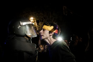A Surround Congress protester squares up to a policeman in Madrid.