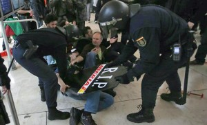 Police clash with Iberia workers.
